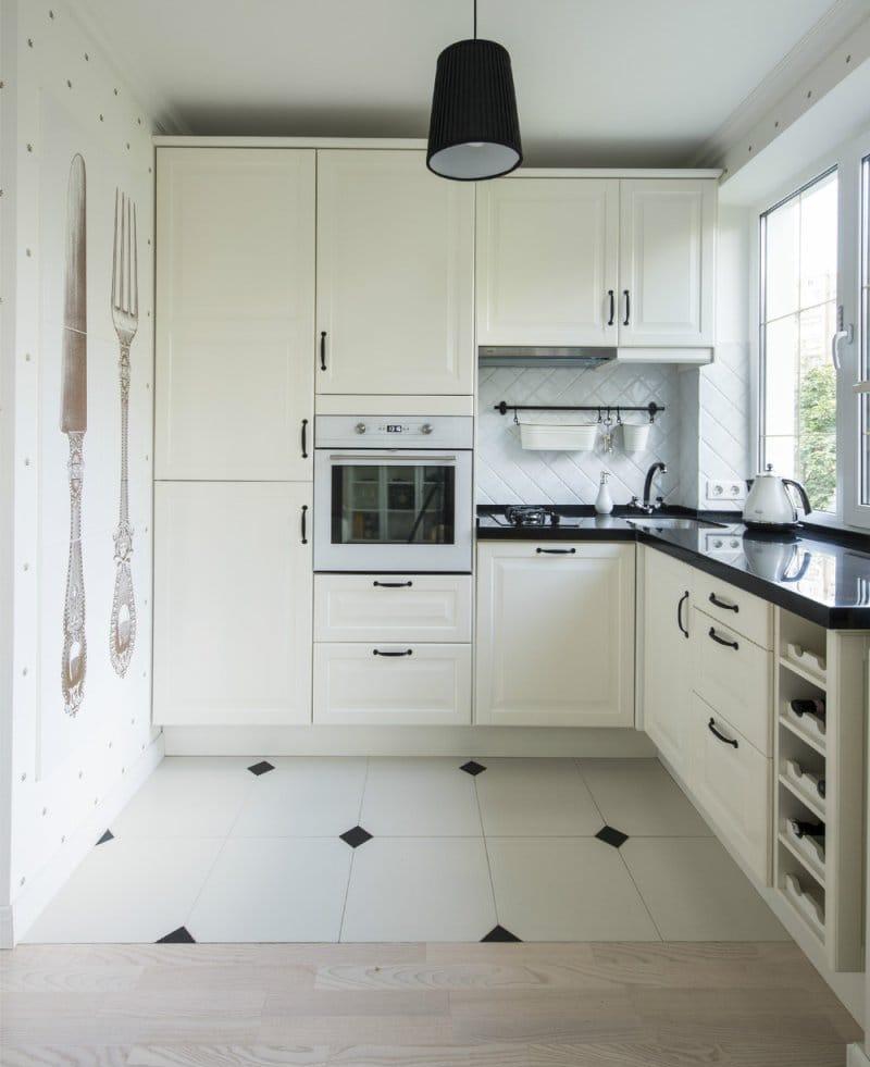 Угловой черно-белый небольшой кухонный гарнитур