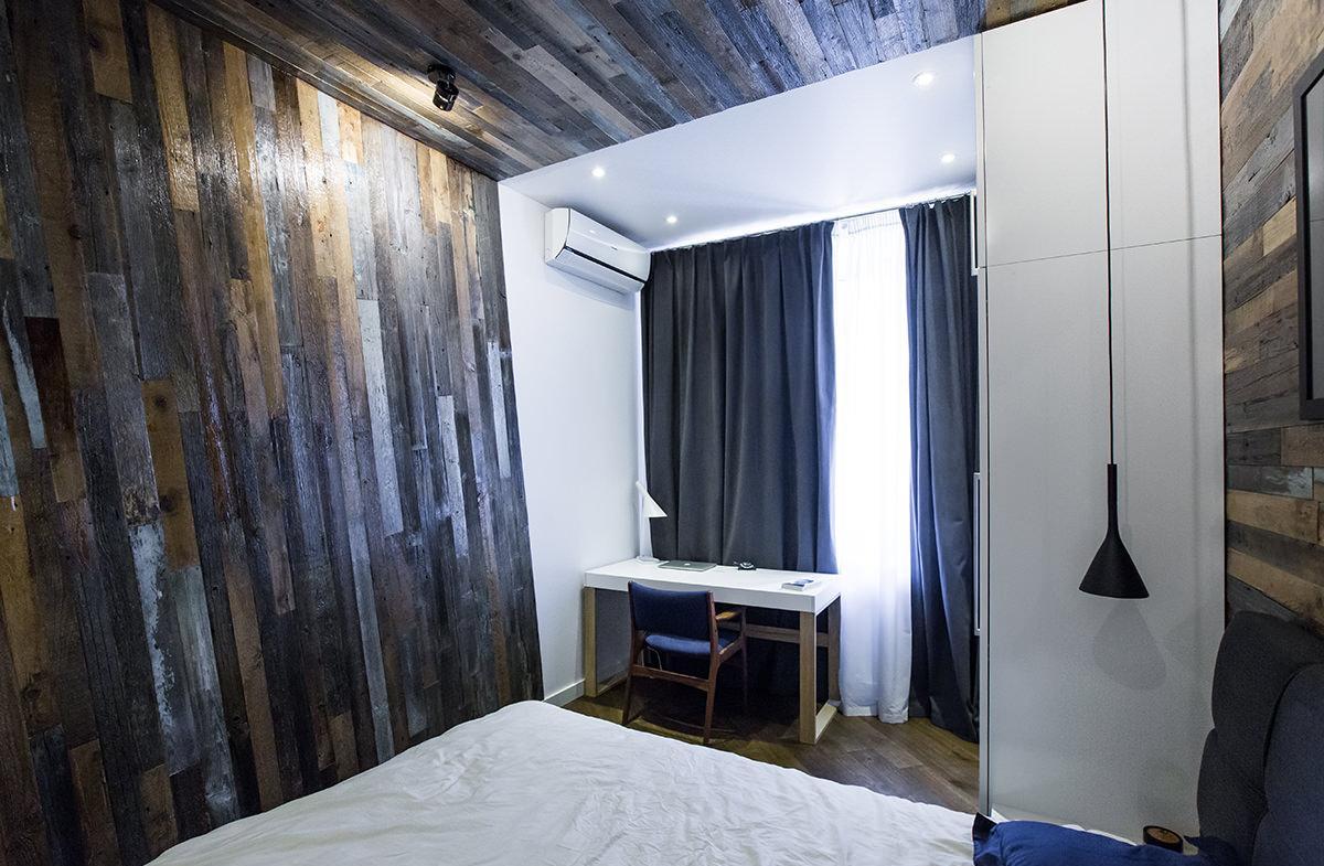Необычный контрастный дизайн спальни с рабочим местом