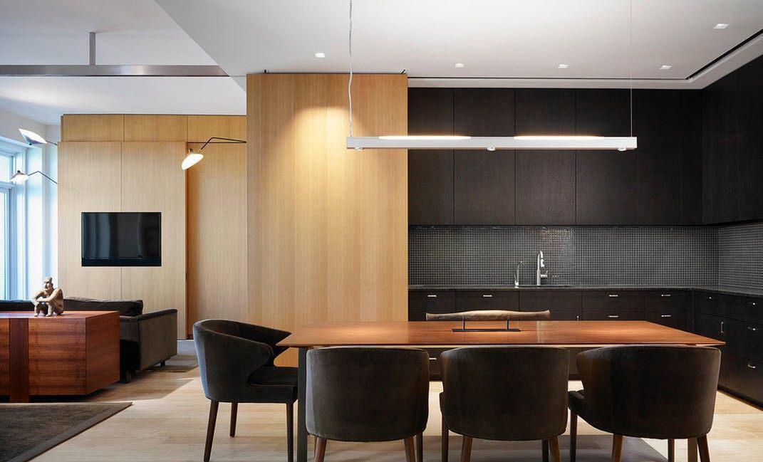 Коричнево-черная гостиная-кухня