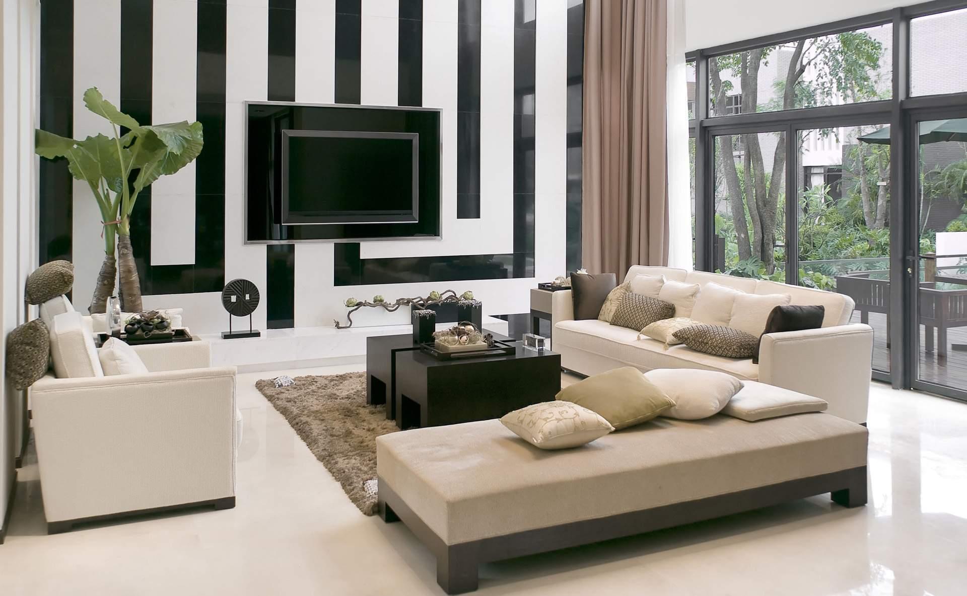Бежевый, белый и черный цвета в интерьере гостиной в стиле модерн