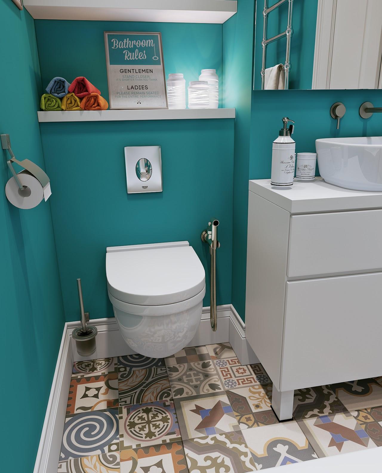 Яркая плитка на полу в бирюзово-белой ванной