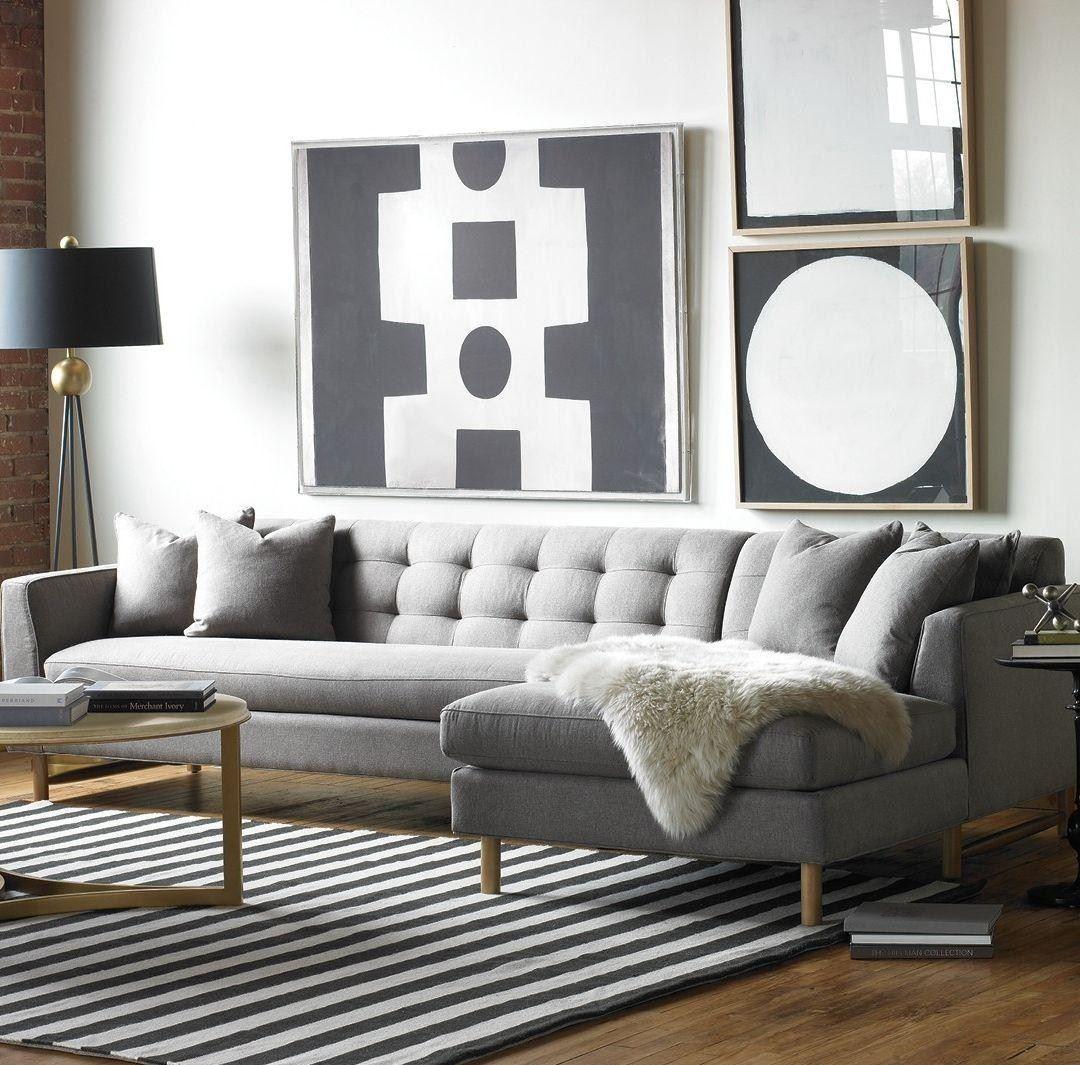 Пружинный диван в интерьере лофт