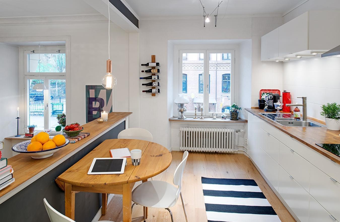 Зонирование кухни-гостиной с помощью барной стойки
