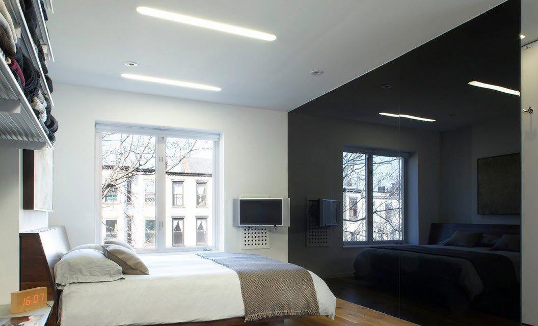 Спальня в стиле минимализм с черной стеклянной перегородкой